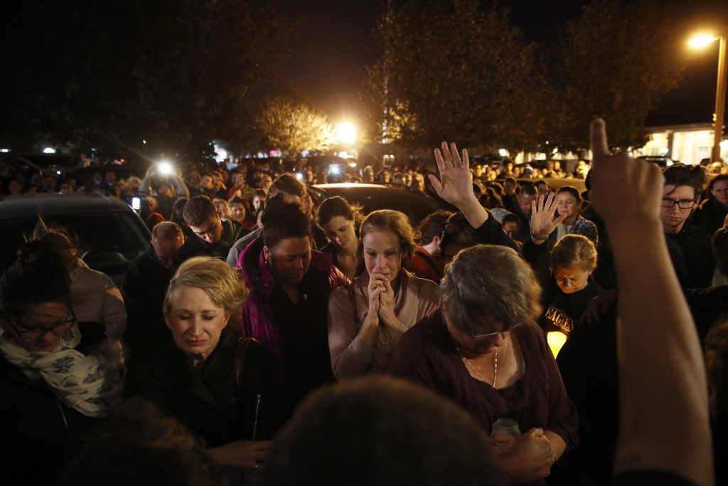 People gather outside the Rivalry Roasters coffee shop for a vigil for Sean Adler Thursday, Nov. 8, 2018, in Simi Valley, Calif. Adler was killed in W...
