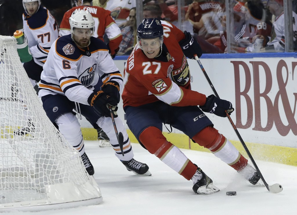Florida Panthers center Nick Bjugstad (27) skates with the puck as Edmonton Oilers defenseman Adam Larsson (6) defends during the second period of an
