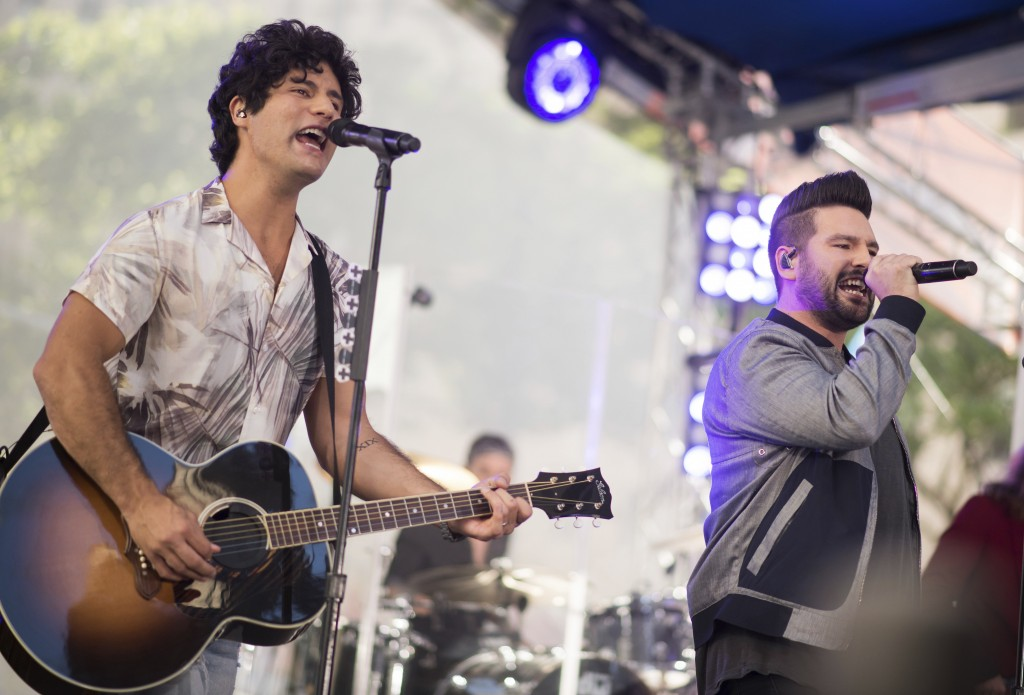 "FILE - In this June 25, 2018 file photo, Dan Smyers, left, and Shay Mooney from the band Dan + Shay perform on NBC's ""Today"" show in New York. The duo"