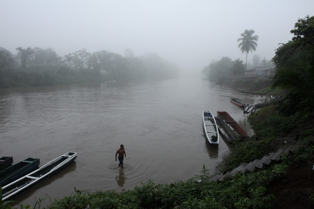 FILE - In this June 22, 2012, file photo, a man bathes in a river at dawn in the Darien Province on the border with Colombia, in Union Choco, Panama.