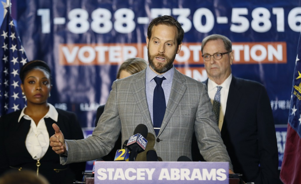 Kurt Kastorf, one of Stacey Abrams' attorneys, speaks during a news conference Thursday, Nov. 8, 2018, in Atlanta. Republican Brian Kemp resigned Thur