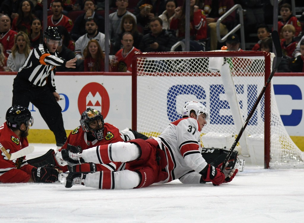 Carolina Hurricanes right wing Andrei Svechnikov (37) scores a goal on Chicago Blackhawks goaltender Corey Crawford (50) during the first period of an