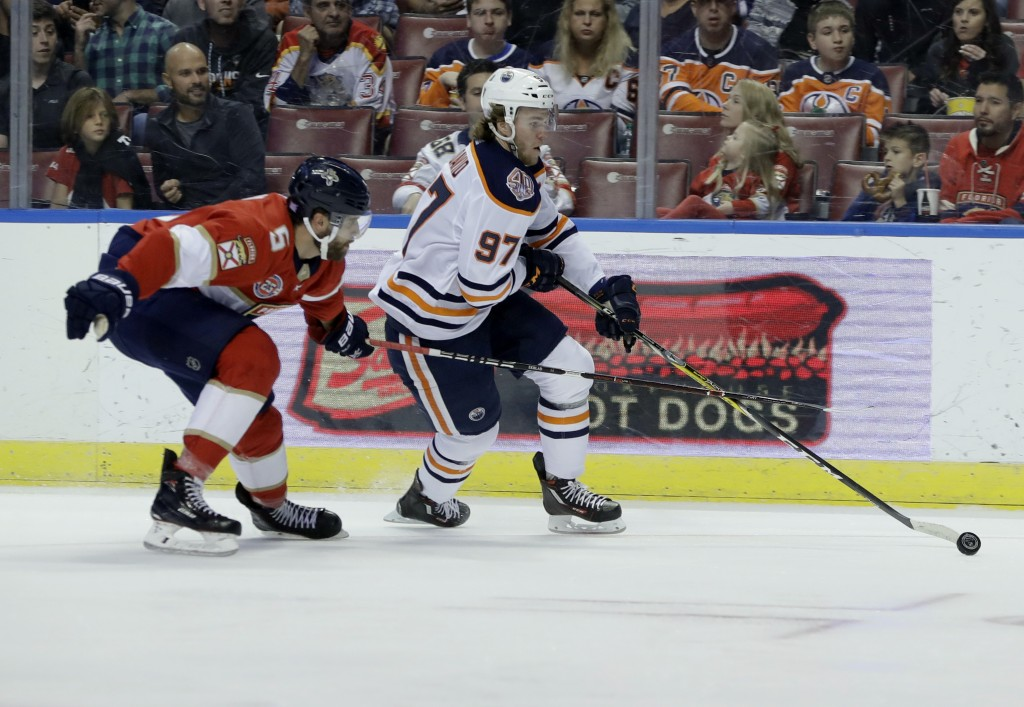 Edmonton Oilers center Connor McDavid (97) skates with the puck as Florida Panthers defenseman Aaron Ekblad (5) defends during the first period of an