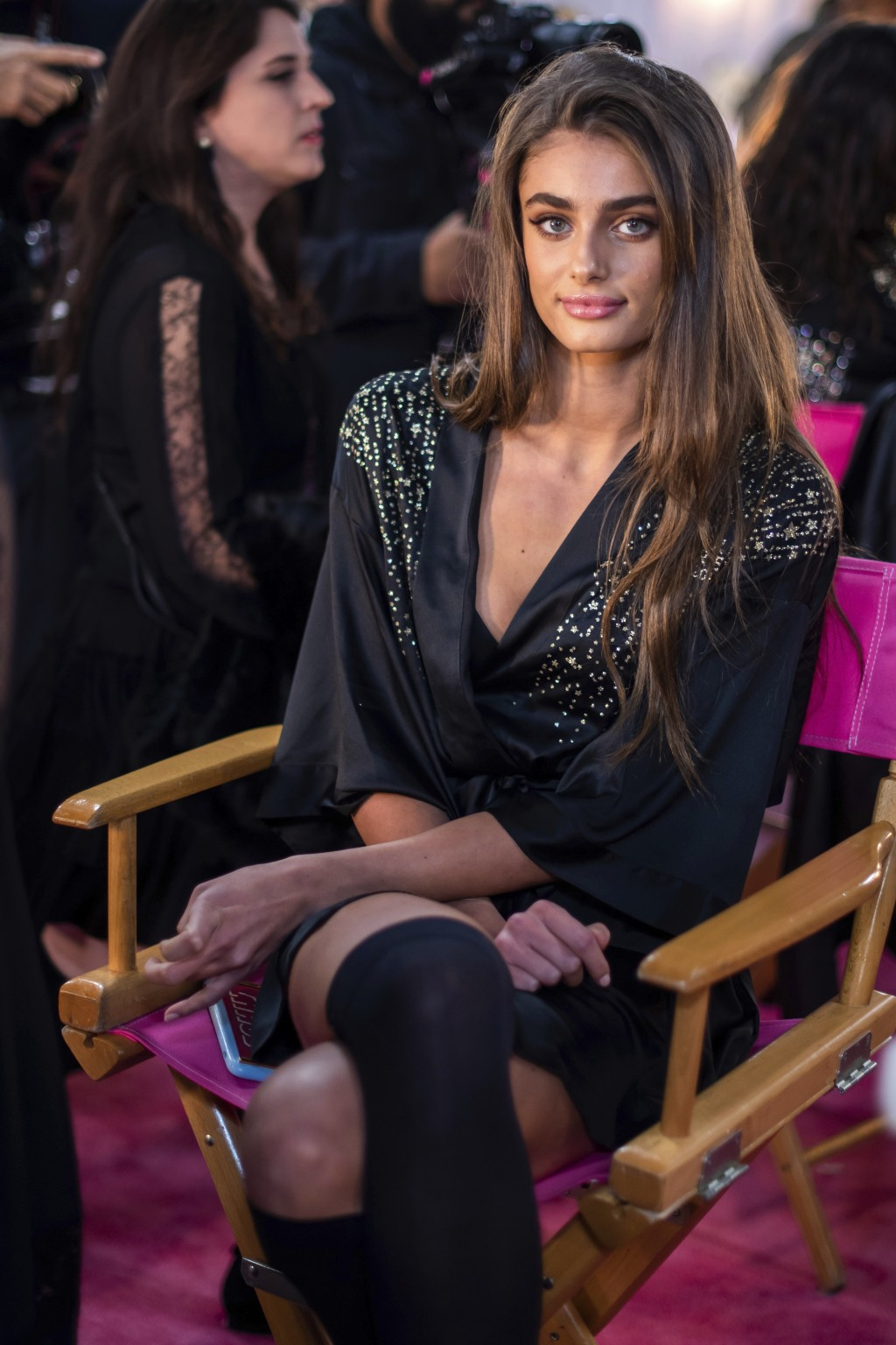 Taylor Hill appears backstage during hair and makeup at the 2018 Victoria's Secret Fashion Show at Pier 94 on Thursday, Nov. 8, 2018, in New York. (Ph