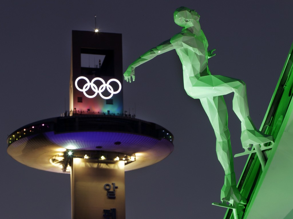 FILE - In this Feb. 9, 2018 file photo, a speed skating figure is displayed in front of the Alpensia Ski Jumping Center ahead of the 2018 Winter Olymp