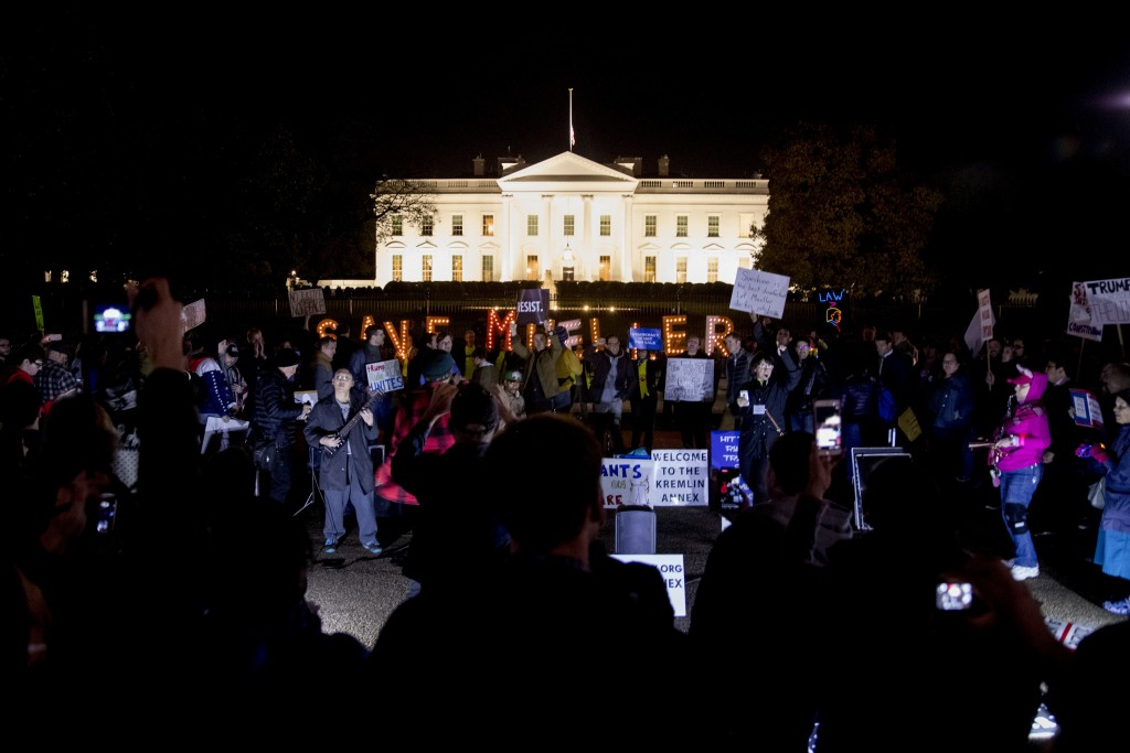 "Protesters gather in front of the White House in Washington, Thursday, Nov. 8, 2018, as part of a nationwide ""Protect Mueller"" campaign demanding that"