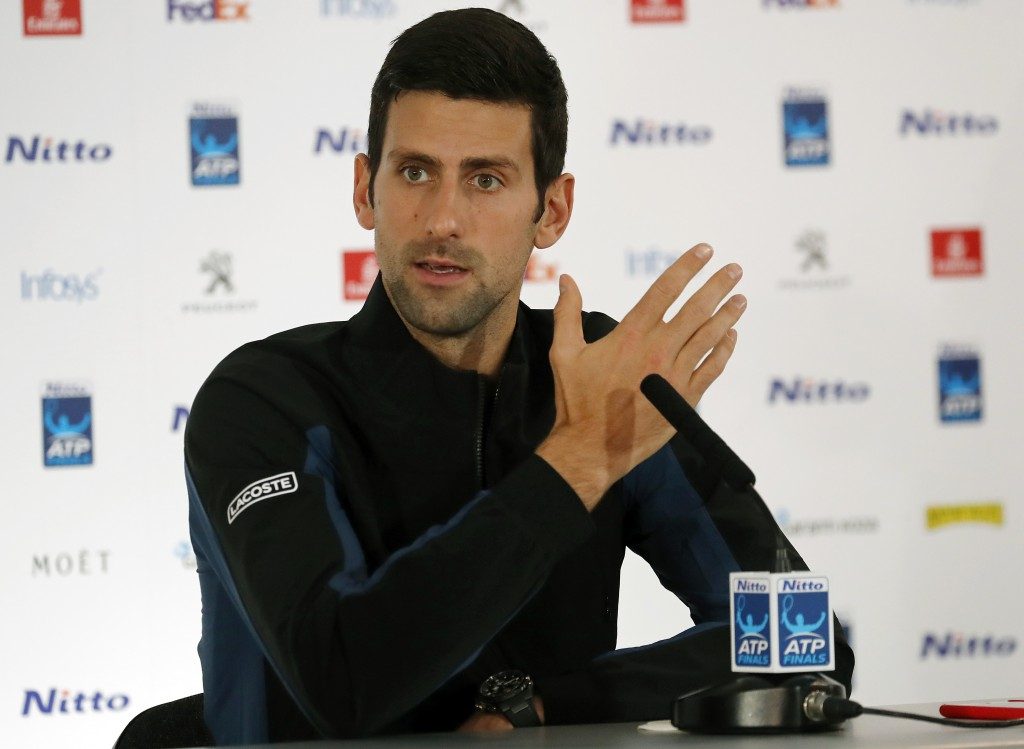 Tennis player Novak Djokovic of Serbia speaks during a press conference before the official launch of the ATP Tennis finals in London, Friday, Nov. 9,