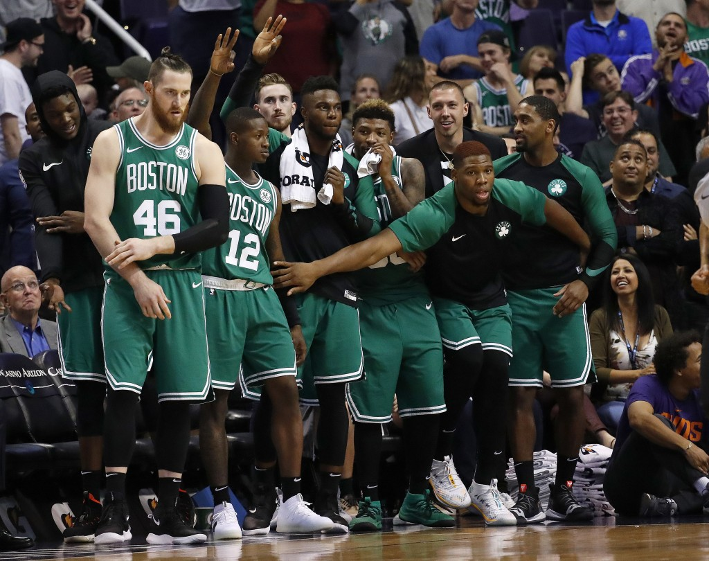 Players on the Boston Celtics bench celebrate as time expires in the second half of the team's NBA basketball game against the Phoenix Suns, Thursday,