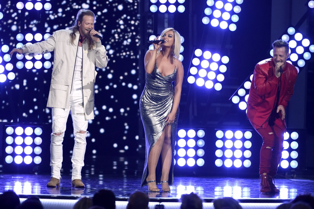 "FILE - In this April 15, 2018 file photo, Tyler Hubbard, right, and Brian Kelley, left, of Florida Georgia Line, and Bebe Rexha, center, perform ""Mean"