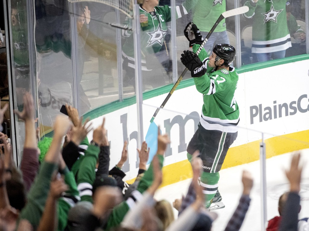 Dallas Stars center Devin Shore celebrates his second goal against the San Jose Sharks, during the third period of an NHL hockey game Thursday, Nov. 8