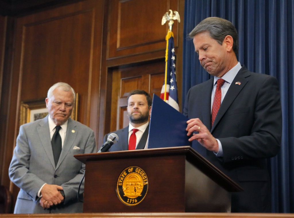 Republican Brian Kemp, right, holds a news conference with Georgia Gov. Nathan Deal, left, in the Governor's ceremonial office at the Capitol on Thurs