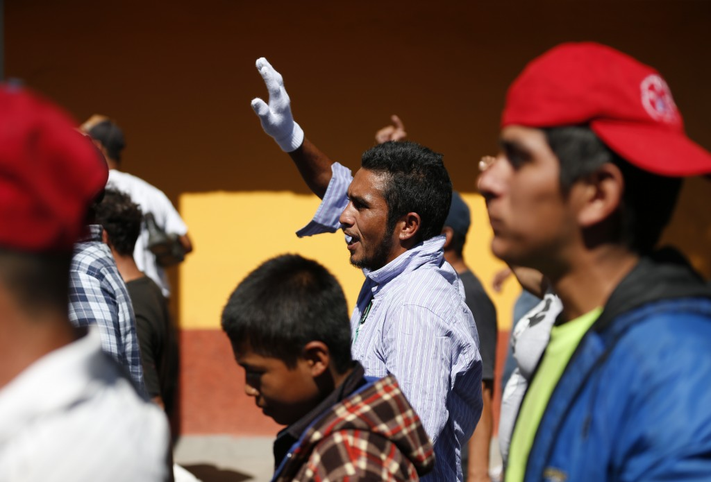 A group of Central American migrants, representing the thousands participating in a caravan trying to reach the U.S. border, undertake an hours-long m