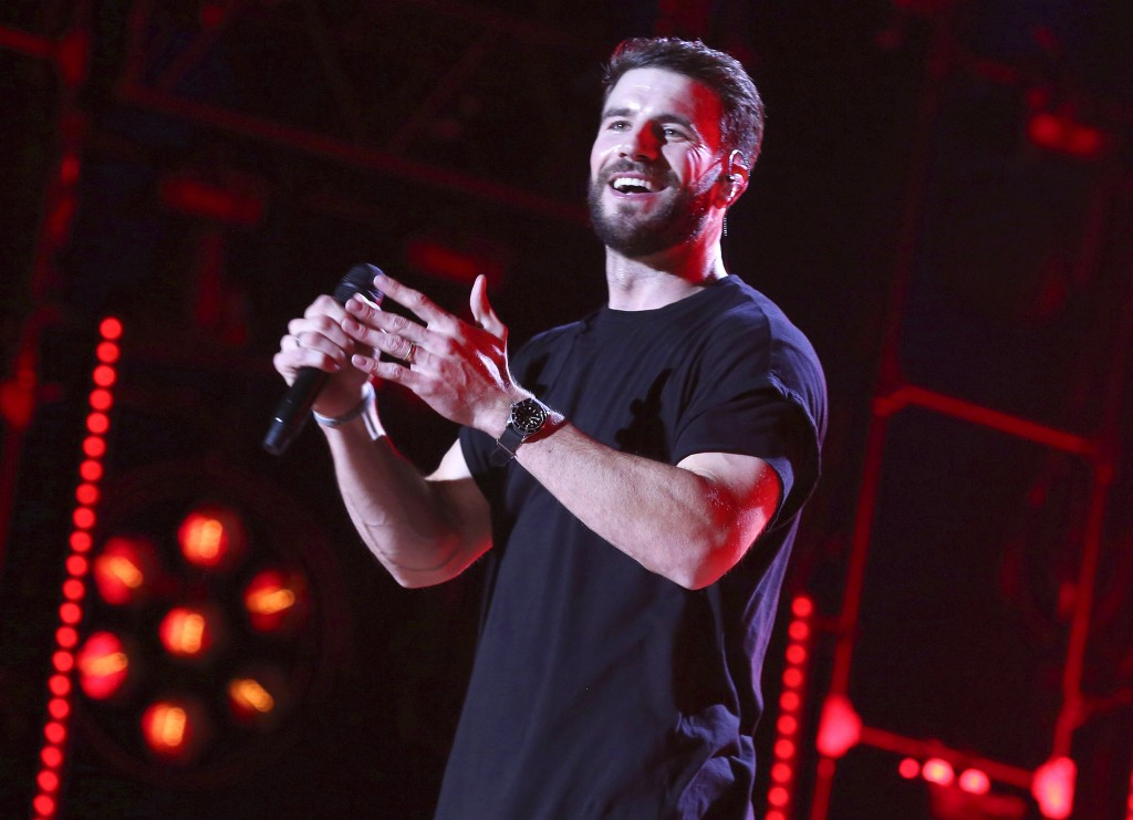 "FILE - In this June 9, 2017 file photo, Sam Hunt performs at the 2017 CMA Music Festival in Nashville, Tenn. Hunt's ""Body Like a Back Road"" is nominat"