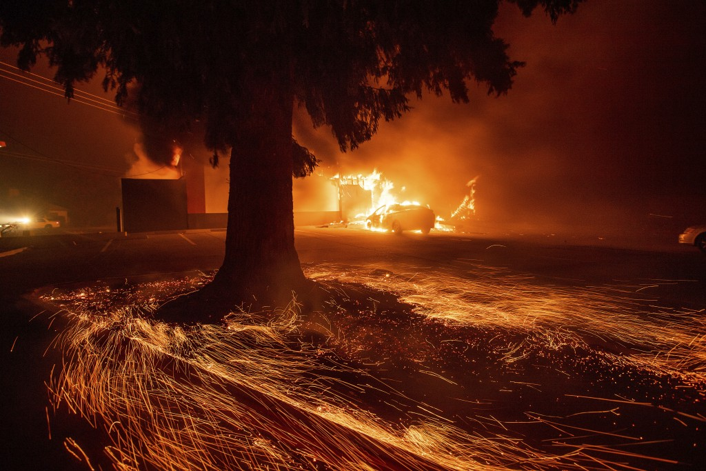 Flames consume a Kentucky Fried Chicken as the Camp Fire tears through Paradise, Calif., on Thursday, Nov. 8, 2018. Tens of thousands of people fled a