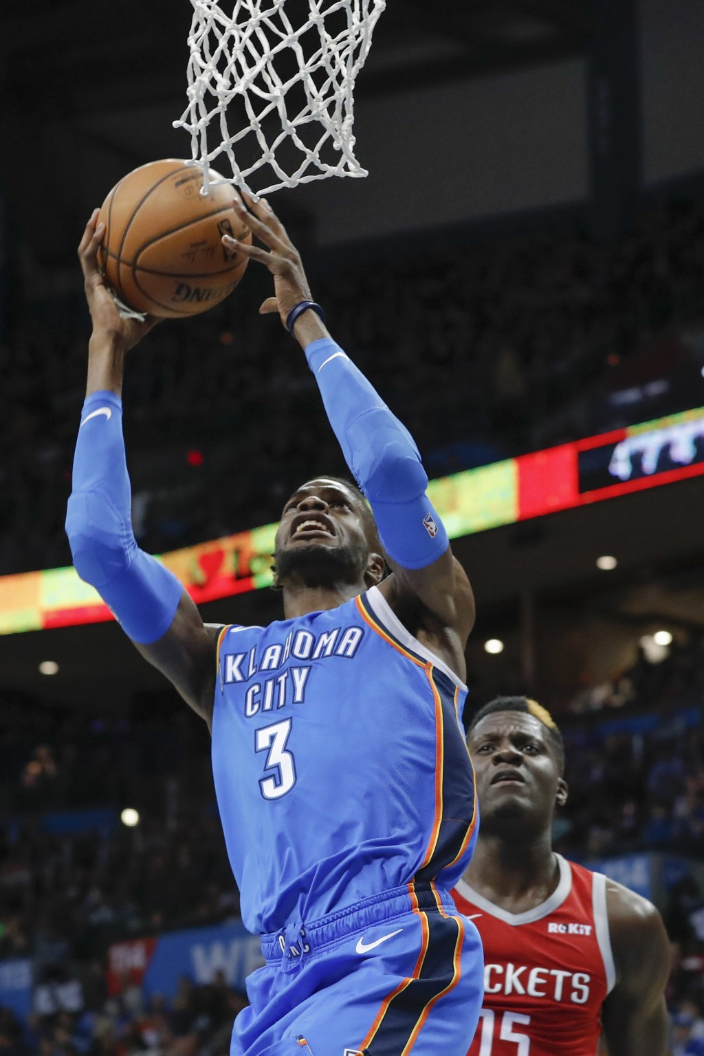Oklahoma City Thunder forward Nerlens Noel (3) goes up for a basket ahead of Houston Rockets center Clint Capela (15) during the first half of an NBA