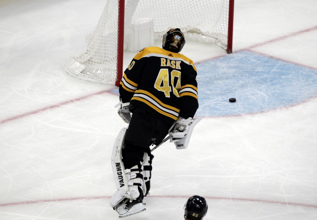 Boston Bruins goaltender Tuukka Rask (40) skates back to the net after a goal by Vancouver Canucks center Bo Horvat during the third period of an NHL