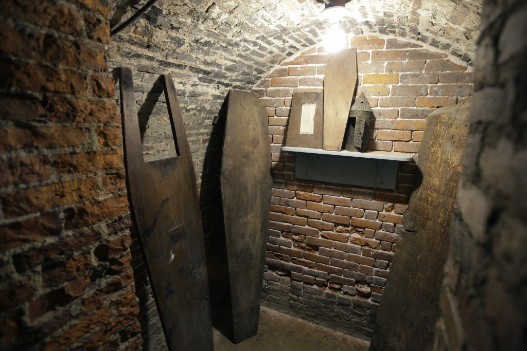 In this Wednesday, Nov. 7, 2018 photo tops of coffins sit in an empty crypt in the basement of Old North Church, in Boston. A memorial honoring fallen