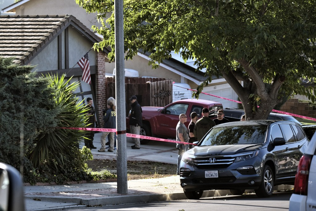 Ventura County Sheriff's deputies and FBI investigators stand outside the house of shooting suspect David Ian Long in Newbury Park, Calif., on Thursda...