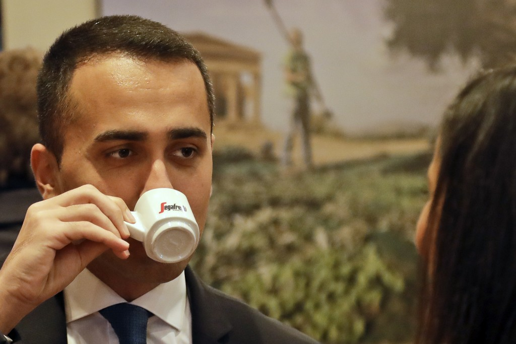 Deputy Premier and Labor Minister Luigi Di Maio enjoys a coffee as he arrives for a press conference at the Foreign Press Association headquarters, in