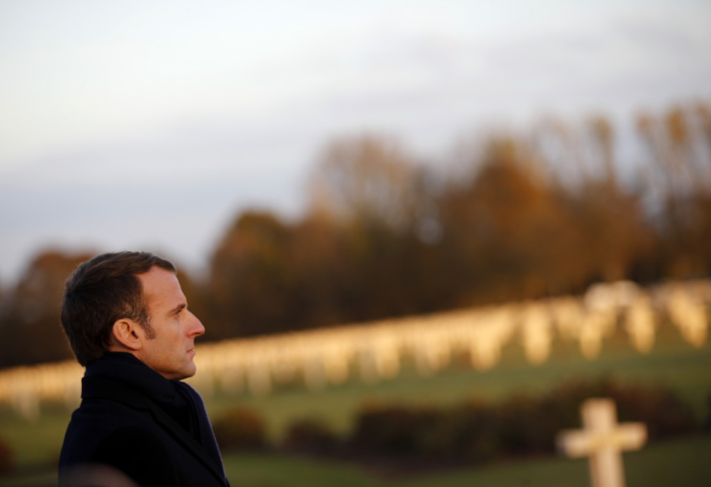 French President Emmanuel Macron looks on at the Notre Dame de Lorette war cemetery near Arras, northern France, Thursday, Nov.8, 2018 as part of cere