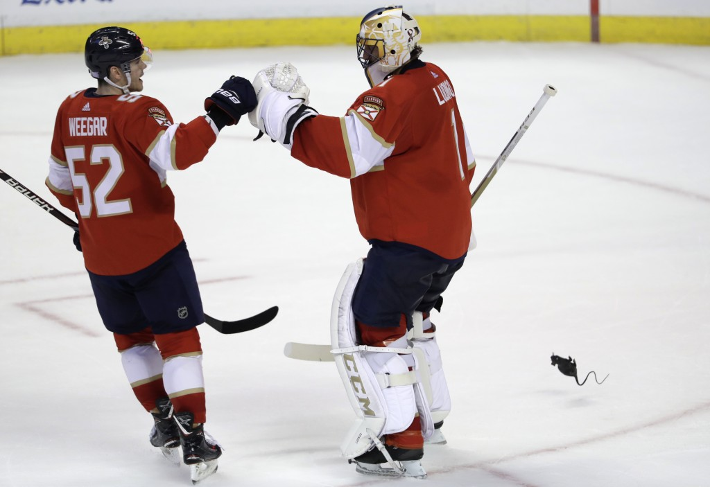Florida Panthers goaltender Roberto Luongo, right, is congratulated by MacKenzie Weegar (52) after the Panthers defeated the Edmonton Oilers 4-1 in an