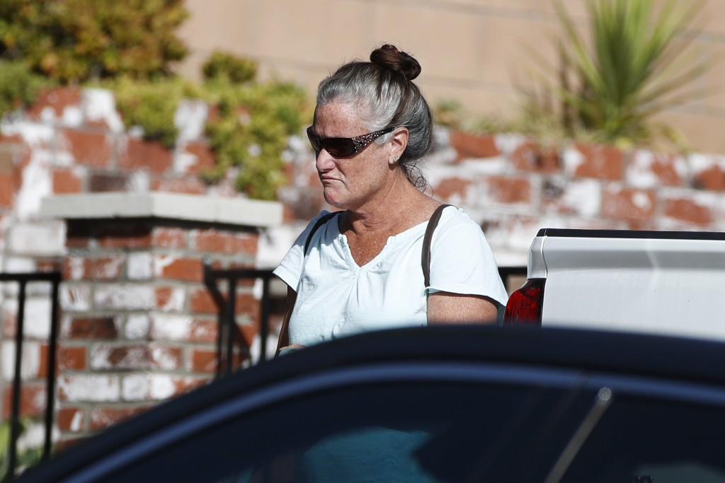 Colleen Long, mother of shooting suspect David Ian Long, leaves her house in Newbury Park, Calif., on Thursday, Nov. 8, 2018. Authorities said the for