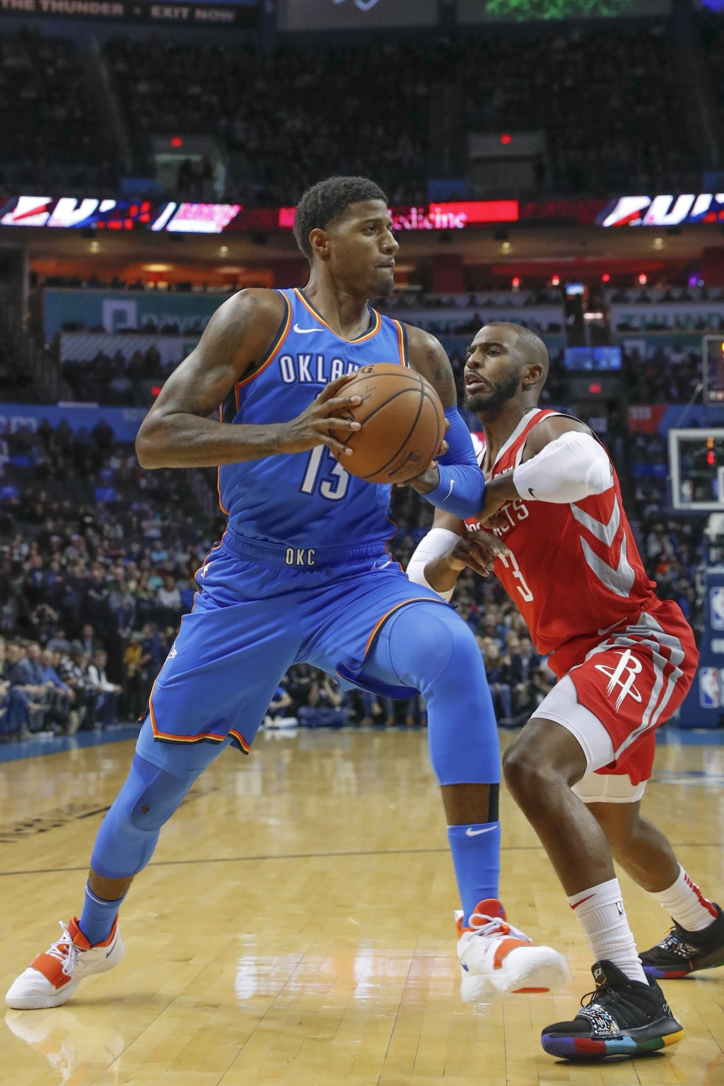 Oklahoma City Thunder forward Paul George (13) drives to the basket against Houston Rockets guard Chris Paul (3) during the first quarter of an NBA ba