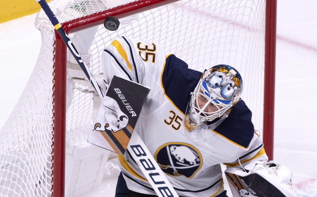 Buffalo Sabres goaltender Linus Ullmark deflects a Montreal Canadiens shot during the first period of an NHL hockey game Thursday, Nov. 8, 2018, in Mo
