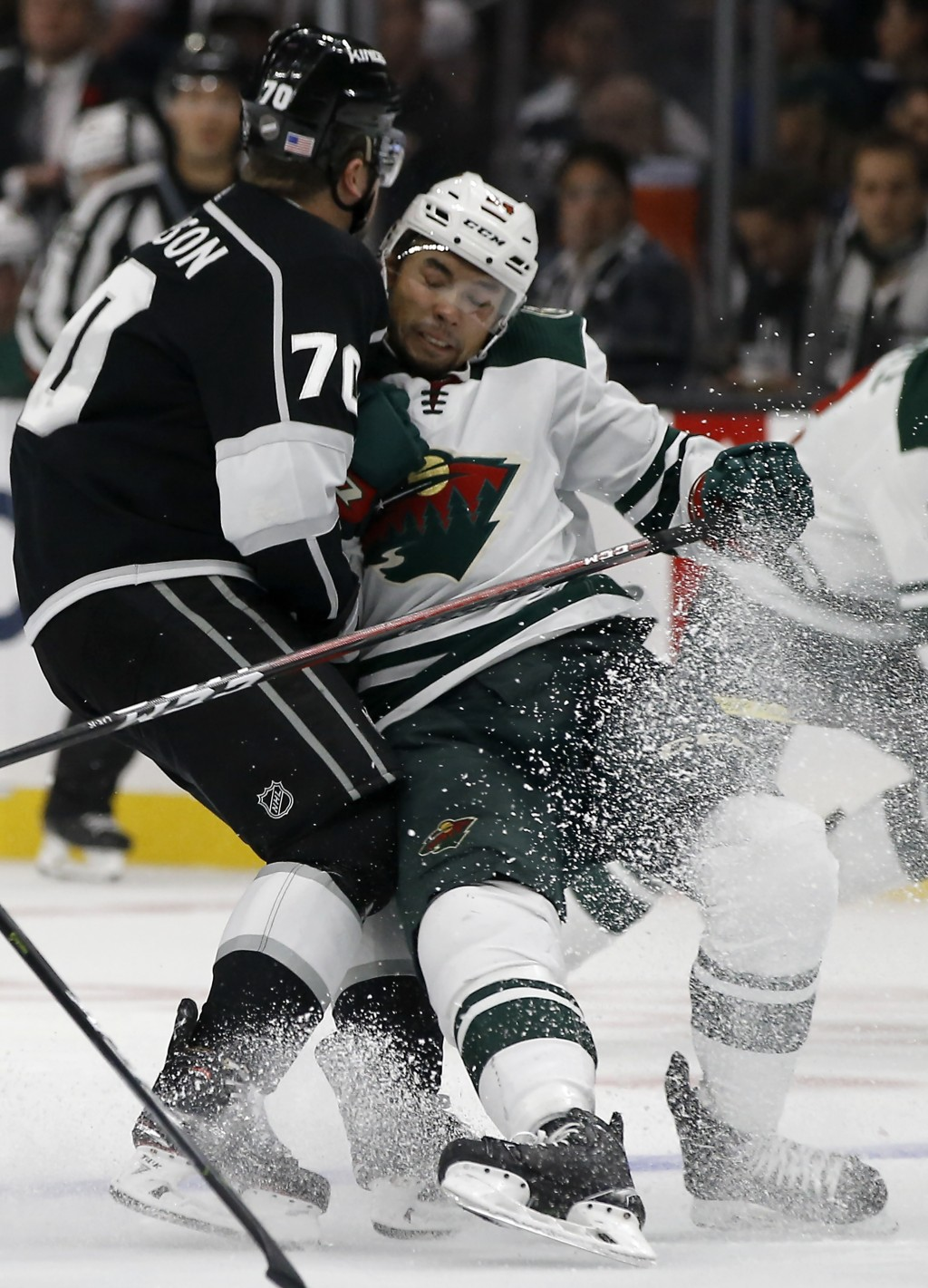 Minnesota Wild defenseman Matt Dumba, right, collides with Los Angeles Kings left wing Tanner Pearson during the second period of an NHL hockey game i