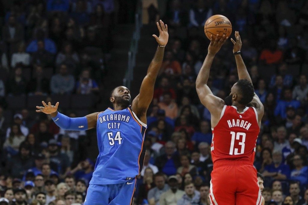 Oklahoma City Thunder forward Patrick Patterson (54) defends as Houston Rockets guard James Harden (13) shoots during the first half of an NBA basketb