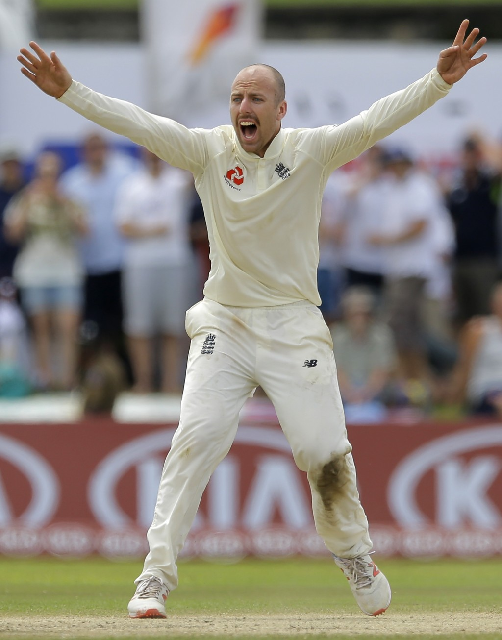 England's Jack Leach successfully appeals to dismiss Sri Lanka's Kaushal Silva during the fourth day of the first test cricket match between Sri Lanka