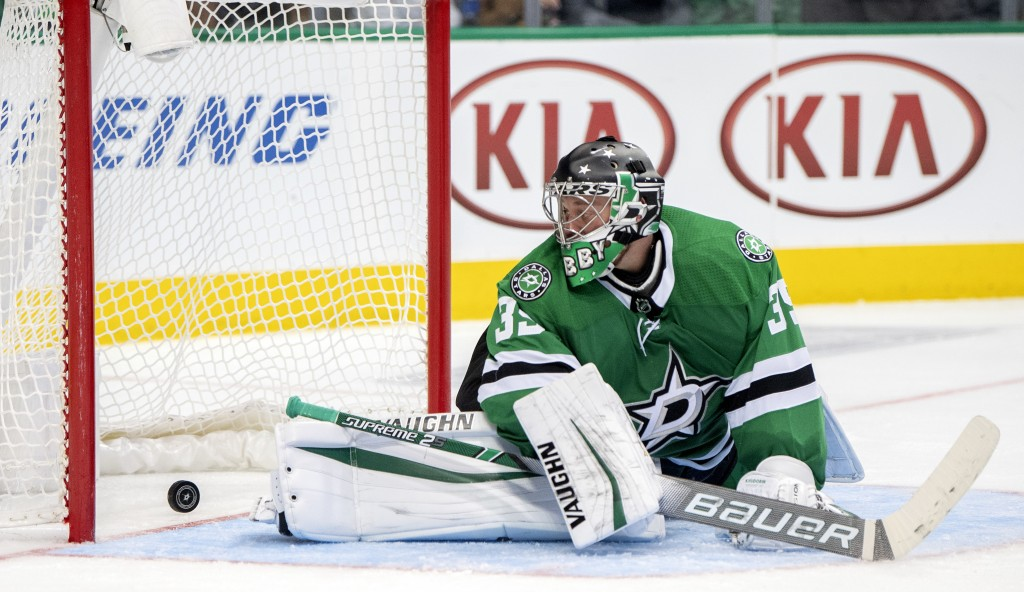 Dallas Stars goaltender Anton Khudobin, of Kazakhstan, watches a goal by San Jose Sharks' Evander Kane go into the net during the second period of an