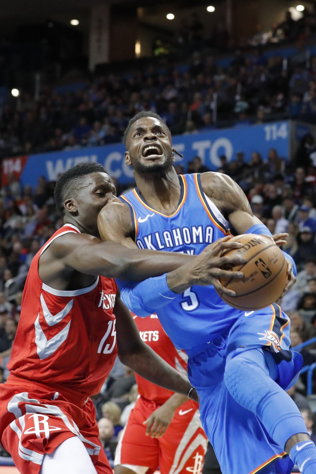 Oklahoma City Thunder forward Nerlens Noel (3) drives to the basket as Houston Rockets center Clint Capela (15) defends during the first half of an NB
