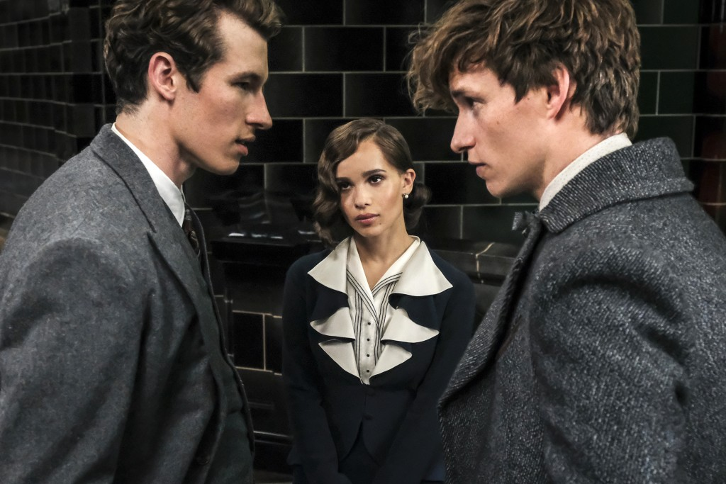 "This image released by Warner Bros. Pictures shows Callum Turner, from left, Zoe Kravitz and Eddie Redmayne in a scene from ""Fantastic Beasts: The Cri"