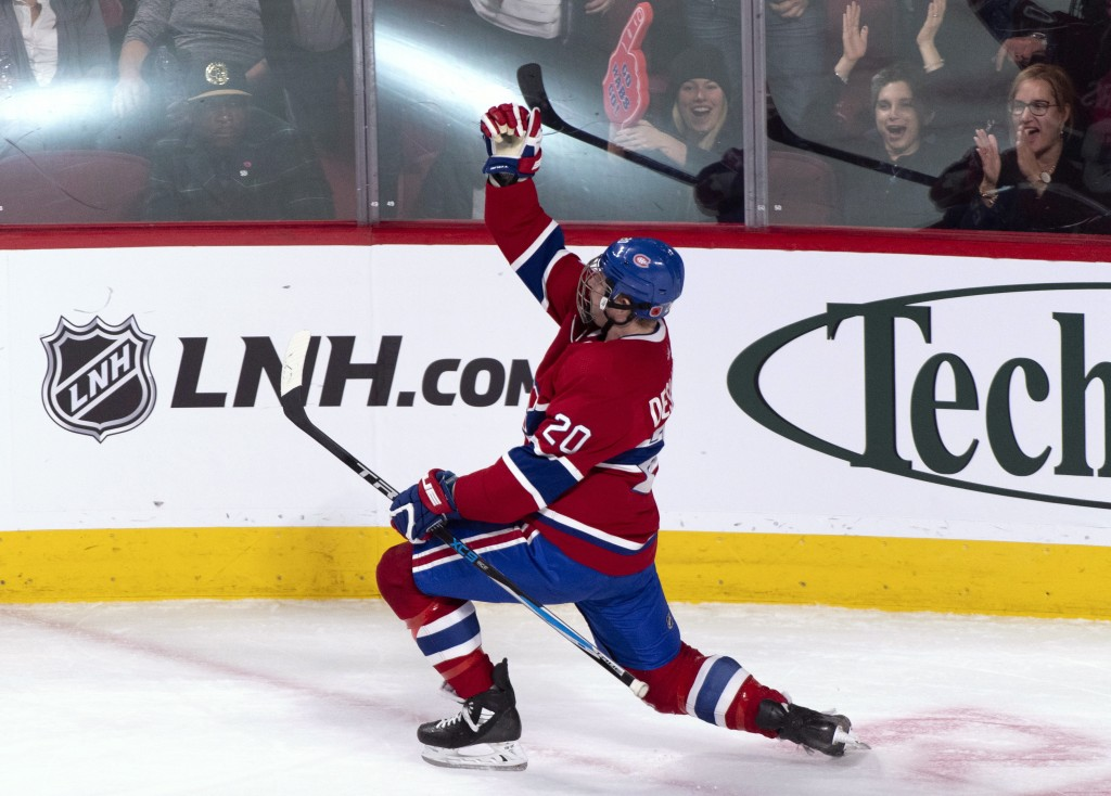 Montreal Canadiens' Nicolas Deslauriers celebrates his short-handed goal against the Buffalo Sabres during the second period of an NHL hockey game Thu