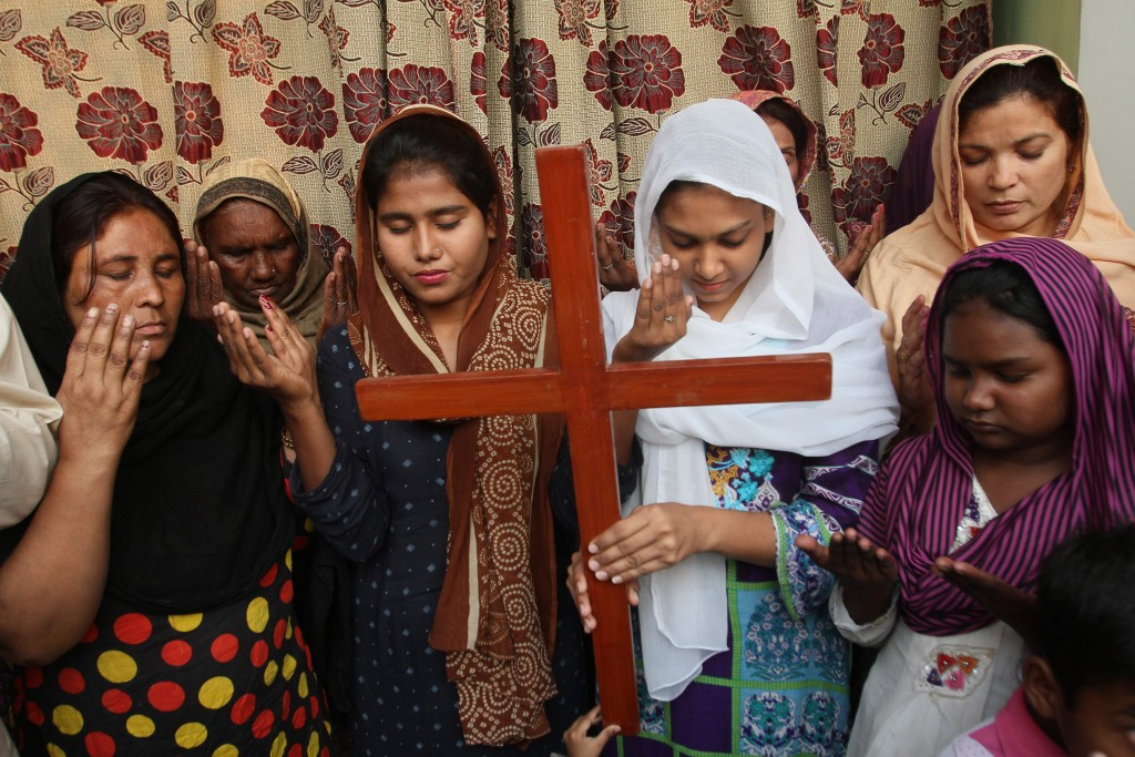 FILE - In this Oct. 31, 2018, file, photo Pakistan Christians pray for Aasia Bibi, a Catholic mother of five who has been on death row since 2010 accu