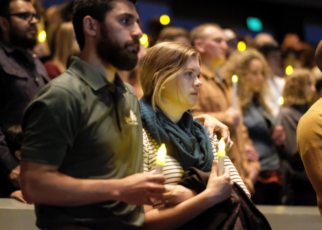 People gather to pray for the victims of the mass shooting during a candlelight vigil in Thousand Oaks , Calif., Thursday, Nov. 8, 2018. A gunman open...