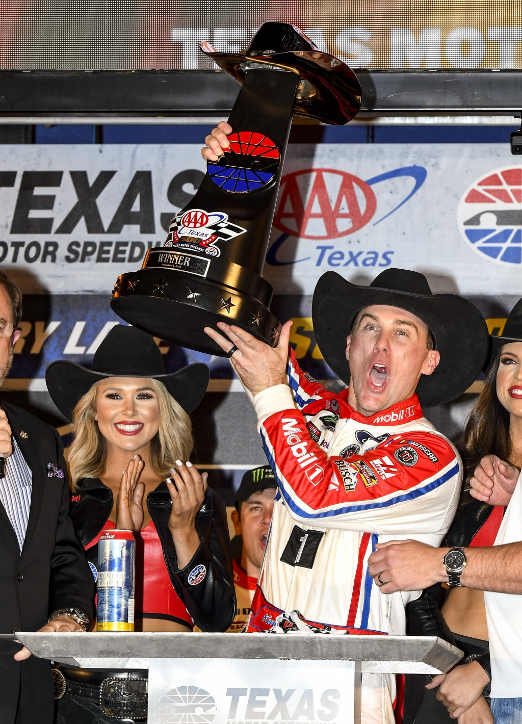FILE - In this Sunday, Nov. 4, 2018, file photo, Kevin Harvick celebrates in Victory Lane after winning a NASCAR Cup auto race at Texas Motor Speedway