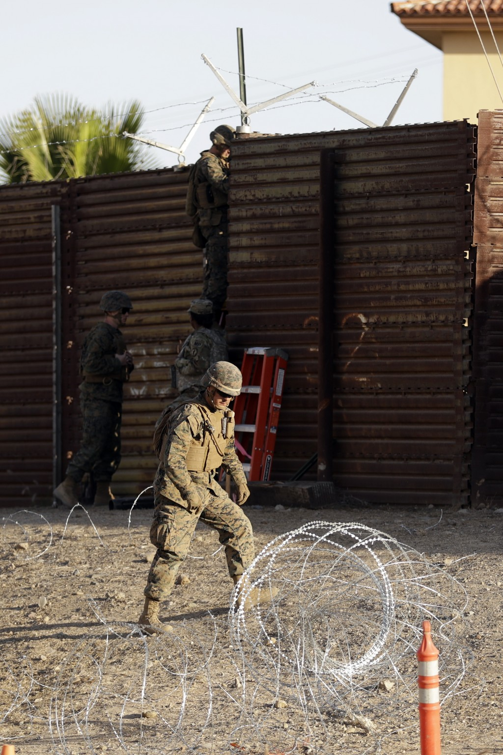Marines work to fortify the border structure that separates Tijuana, Mexico, and San Diego, near the San Ysidro Port of Entry, Friday, Nov. 9, 2018, i