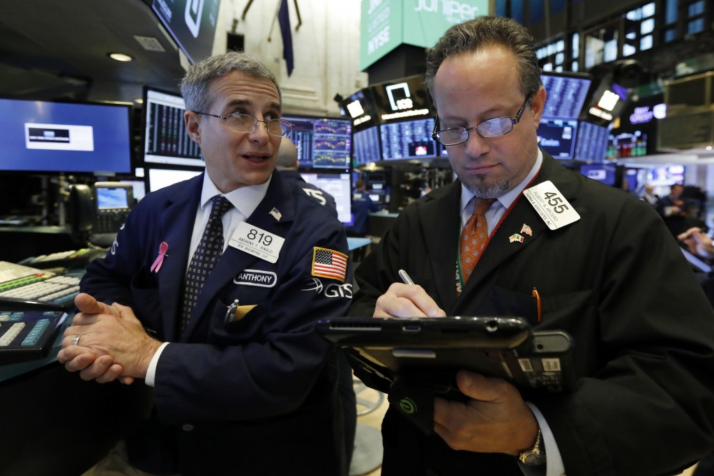 Specialist Antony Rinaldi left, and trader Robert Arciero work on the floor of the New York Stock Exchange, Friday, Nov. 9, 2018. Stocks are falling a