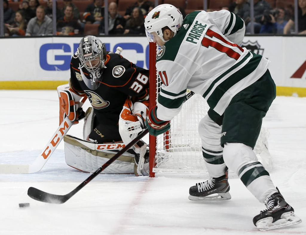 Minnesota Wild left wing Zach Parise, right, takes a shot against Anaheim Ducks goaltender John Gibson, left, during the first period of an NHL hockey