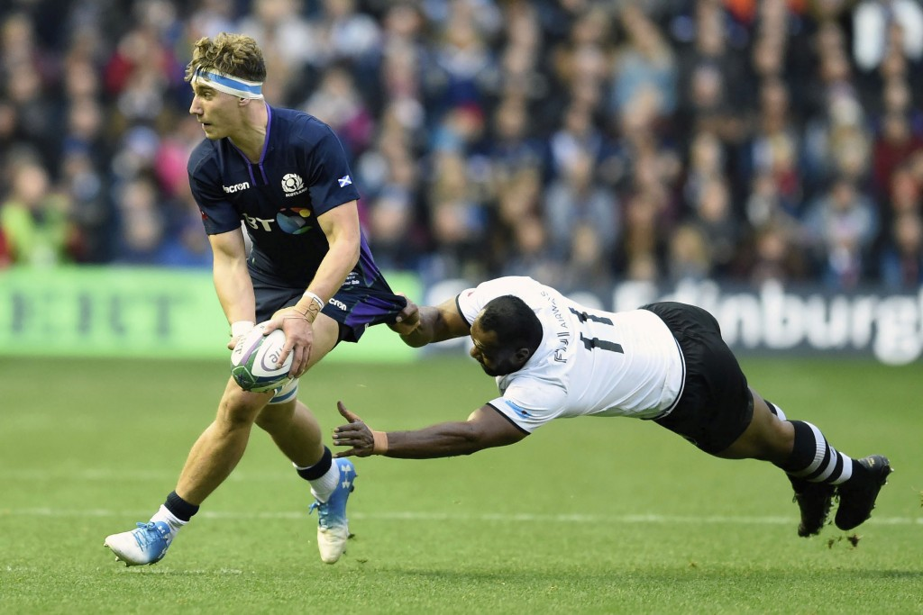 Jamie Ritchie of Scotland, left, is tackled by Vereniki Goneva of Fiji during the International Rugby match between Scotland and Fiji, at the BT Murra