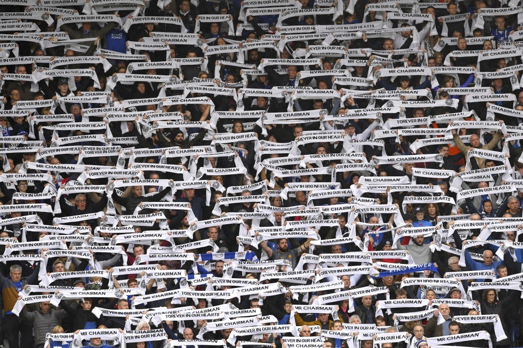 Fans hold scarves for Leicester City Chairman Vichai Srivaddhanaprabha during the Premier League match at the King Power Stadium, Leicester. Saturday