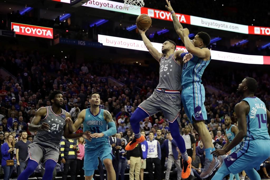 Philadelphia 76ers' Ben Simmons (25) goes up for a shot against Charlotte Hornets' Miles Bridges (0) during overtime of an NBA basketball game, Friday