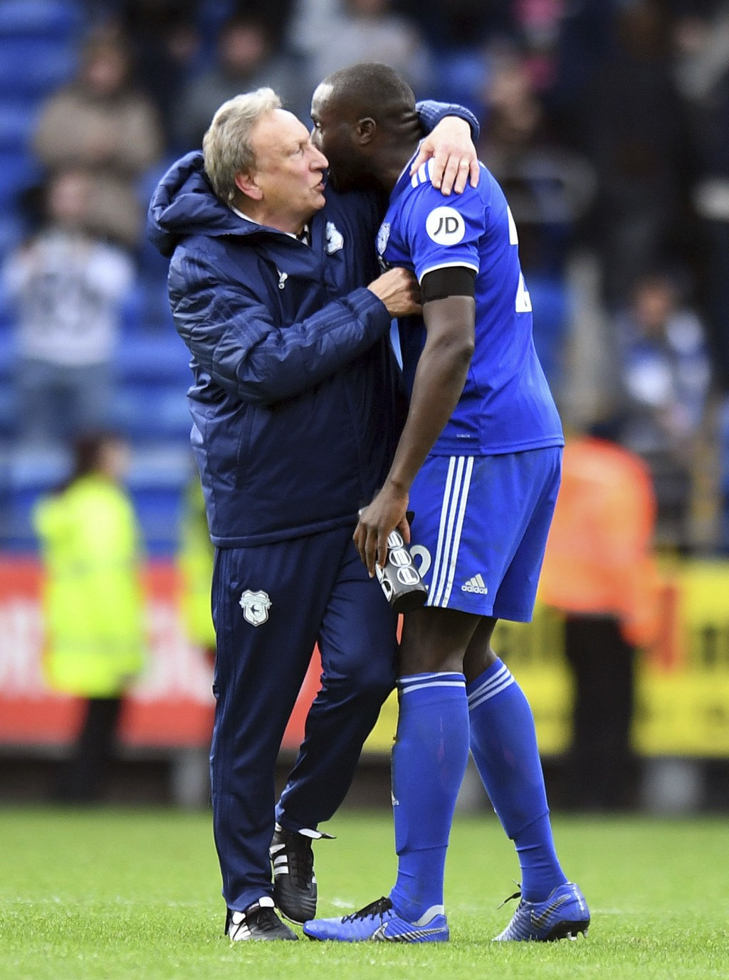 Cardiff City manager Neil Warnock, left, embraces winning goal scorer Sol Bamba after the English Premier League soccer match between Cardiff City and