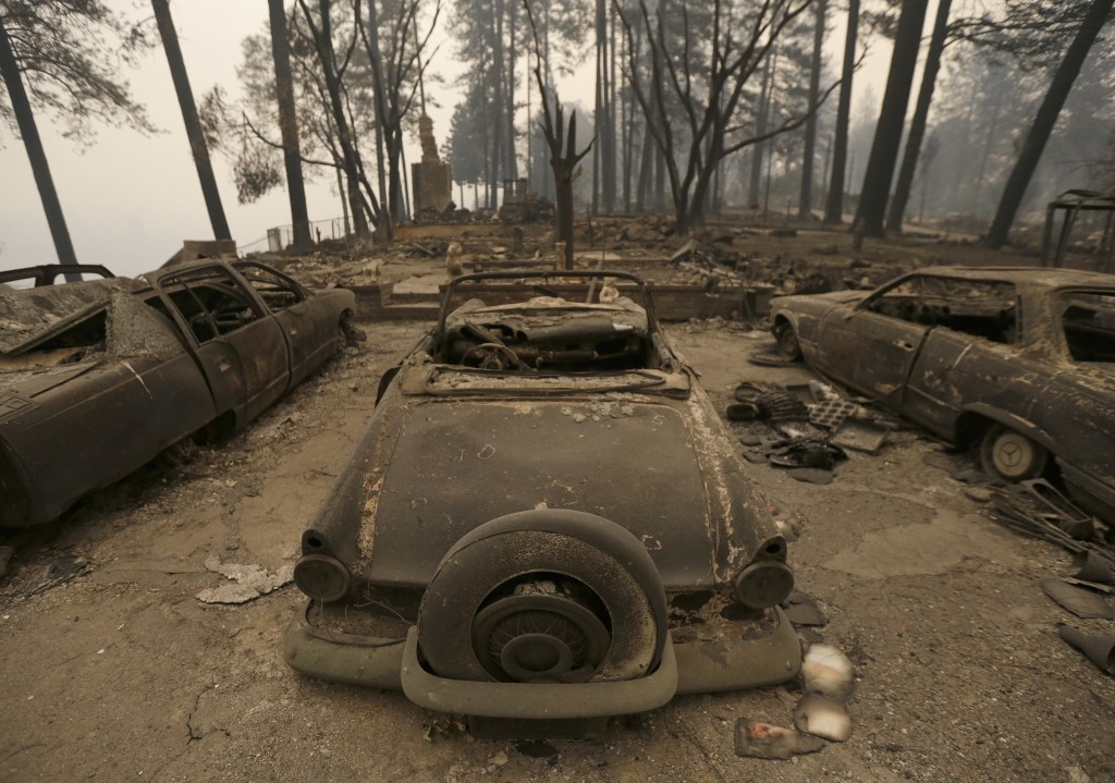 Three cars destroyed by a wildfire sit at a burned out home Friday, Nov. 9, 2018, in Paradise, Calif. Authorities have confirmed that at least six peo...