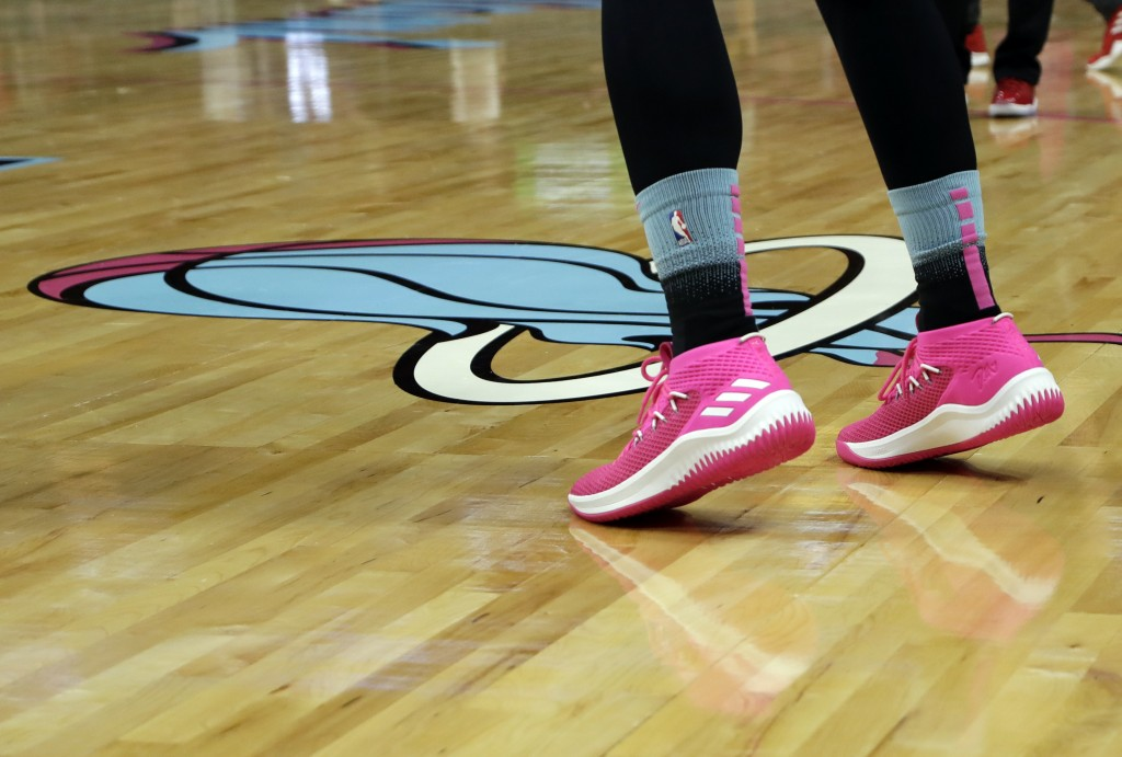 Miami Heat guard Goran Dragic warms up wearing pink shoes as the team unveiled its new Vice Nights City Edition uniforms before an NBA basketball game