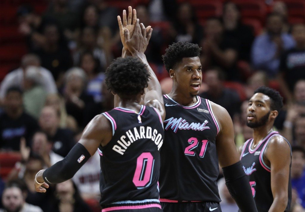 Miami Heat center Hassan Whiteside (21) celebrates with guard Josh Richardson (0) after scoring and drawing a foul during the first half of the team's