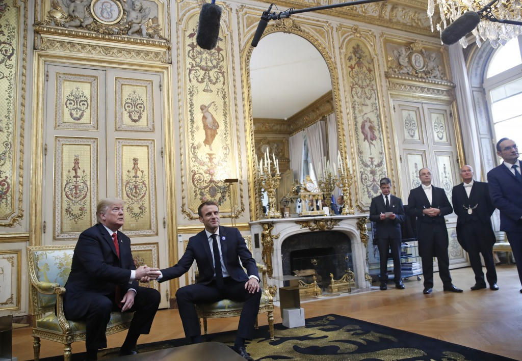 President Donald Trump shakes hands with French President Emmanuel Macron inside the Elysee Palace in Paris Saturday Nov. 10, 2018. Trump is joining o