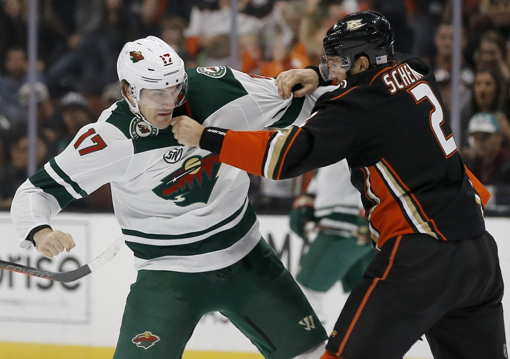 Minnesota Wild left wing Marcus Foligno, left, squares off with Anaheim Ducks defenseman Luke Schenn during the first period of an NHL hockey game in